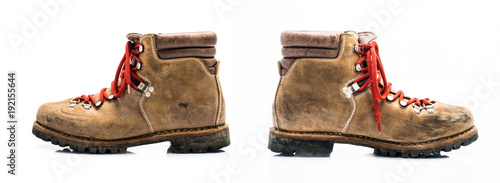 Fotografía  Two old leather mountain shoe isolated on white background