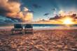 Sunrise, beach chairs on the tropical caribbean beach.