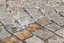 Water Drop, Splash On A Brick ...