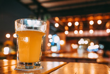 One Pint Of Beer On Restaurant Table With Copy Space On Blur Bokeh Background. Happy Event Celebrations, Nightlife At Pub, Dinner Party, Or Alcoholic Drinks Advertisement Concept