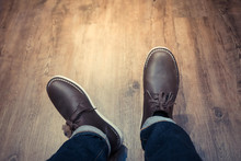 Model Showing New Boots Shoes On A Wooden Floor