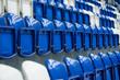 Dark blue metal empty seats in concert or hockey stadium, Row of seats in sport stadium.