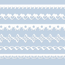 Set Of Seamless Paper Laces On The Blue Background