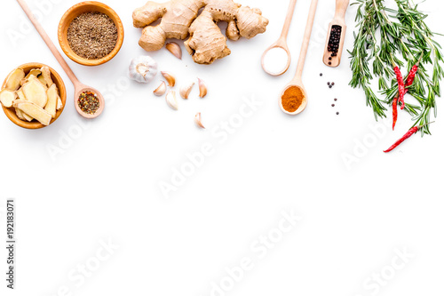 Fototapeta Seasoning background. Dry spices near ginger, garlic, rosemary, chili on white background top view copy space obraz