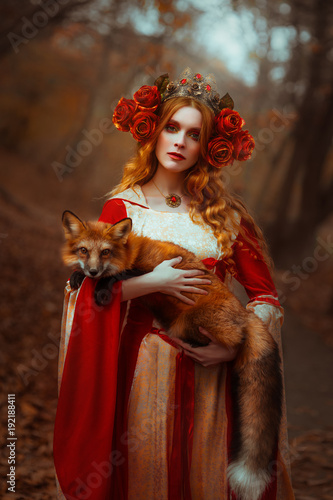 Canvas Print Woman in medieval clothes with a fox