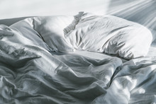 White Crumpled Bed With Pillow...