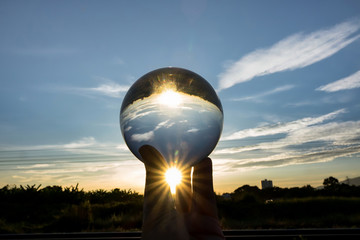 Glass ball display shining glass ball, abstract meaning the prediction of happiness life journey in the future.