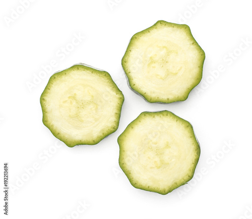 Three green zucchini round slices top view isolated on white background raw courgette pieces Wallpaper Mural