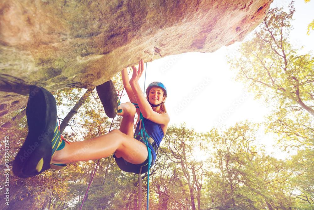 Fototapety, obrazy: Rock climber training outdoors at sunny day