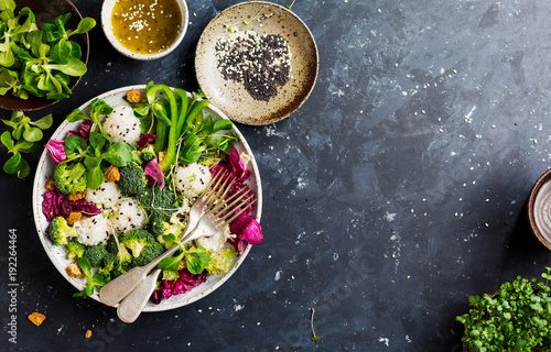 Photo sur Toile Plat cuisine Fresh salad with rice and vegetable on dark background top view with space for text. Healthy food.