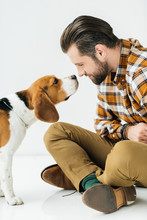 Side View Of Dog Sniffing Man Nose