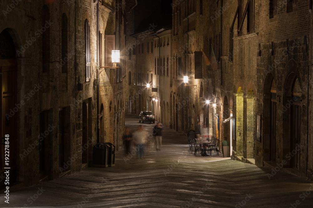 Medieval streets of San Gimignano at night, Tuscany, Italy