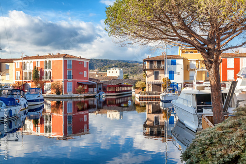 Garden Poster Pale violet Colorful city on the water, Port of Grimaud, Côte d'Azur, France, Provence, houses and boats. Beautiful city landscape