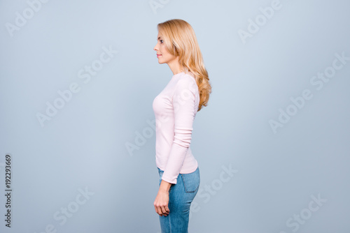 Valokuva  Side half-faced profile view photo of attractive beautiful cheerful concentrated
