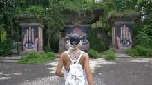 Female Traveler Explores Abandoned Theme Park, Beautiful Graffiti Backdrop