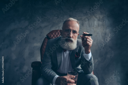 Fényképezés  Minded, ponder rich man in glasses, hold cigarette, glass with brandy, in tuxedo