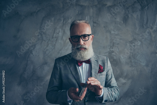 Cuadros en Lienzo Professional, experienced, cunning, old gambler in tux with bow, glasses, shuffl