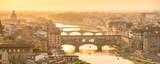 Panoramic aerial view of Florence at sunset  with the Ponte Vecchio and the Arno river, Tuscany, Italy