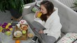 young woman eating breakfast in the morning