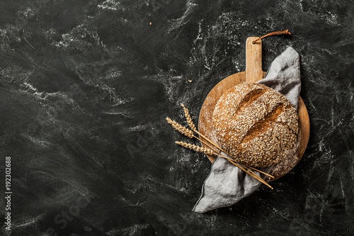 Recess Fitting Bread Bakery - round loaf of rustic bread on black background