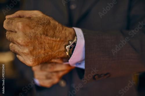 Close-up of man adjusting his cuffs