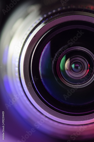 The camera lens and light red. Vertical photo Wall mural