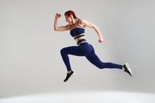 Woman In Blue Sportswear Running