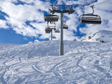 Ski Lift And Ski Slope With Skiers Under It On Sunny Winter Day With Blue Sky. Alpine Resort Meribel, France. Europe, January, 2018
