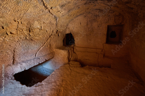 Fotografiet ancient burial chamber at the 'Tomb of the Kings in Paphos, Cyprus