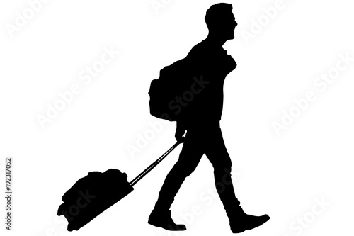 Traveler with suitcase and backpack