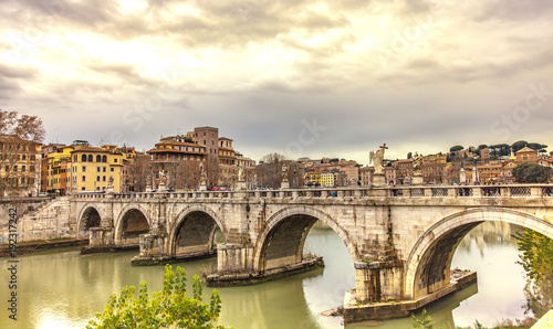 Poster Artistic monument Ponte Sant Angelo over the river Tiber in Rome Italy Europe Winter Travel Cities