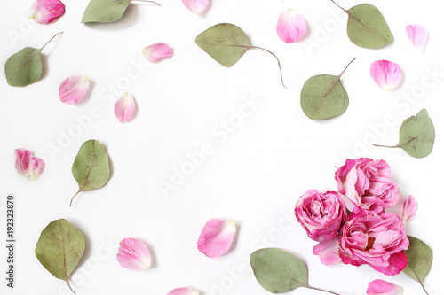 Foto op Canvas Bloemen Styled stock photo. Feminine wedding desktop composition with pink roses petals and flowers, dry green eucalyptus leaves and white background. Floral pattern. Empty space. Top view. Picture for blog.