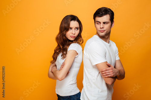Fotografía  Displeased young couple standing with one another's back
