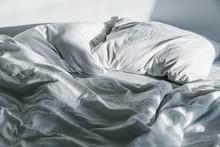 Crumpled Bed On Sunrise Sun Lights