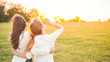 canvas print picture Two young women are looking forward tothe sunset. Best friends