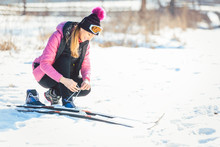 Woman Cross Country Skier Putt...
