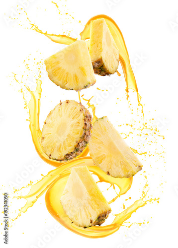 pineapple slices in juice splash isolated on a white background