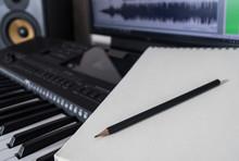 Piano Keyboard, Pen And Sheet....