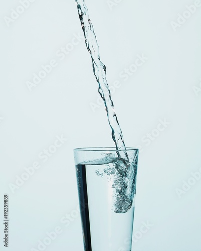 Water pouring into drinking glass