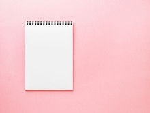 Blank Notepad White Page On Pink Desk, Color Background. Top View,  Empty Space For Text.