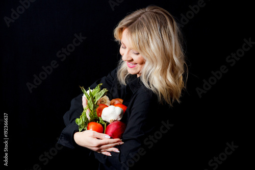Fotografie, Obraz  Woman Holding Italian Vegetables On A Black Background