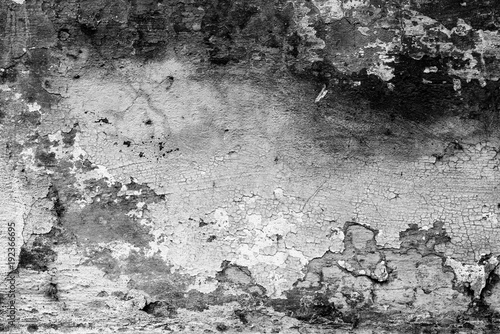 Fototapeta Wall fragment with scratches and cracks