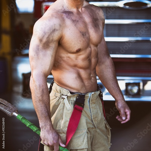 Sexy firefighter muscular body Canvas Print