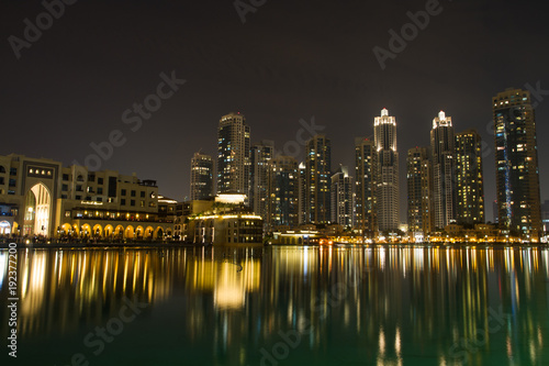 Reflection Of Illuminated Buildings On Sea At Night