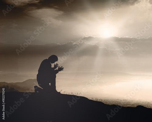 Prayer kneeling and praying to God on mountain autumn sunset background Canvas-taulu