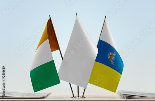 Tuinposter Canarische Eilanden Flags of Ivory Coast and Canary Islands with a white flag in the middle