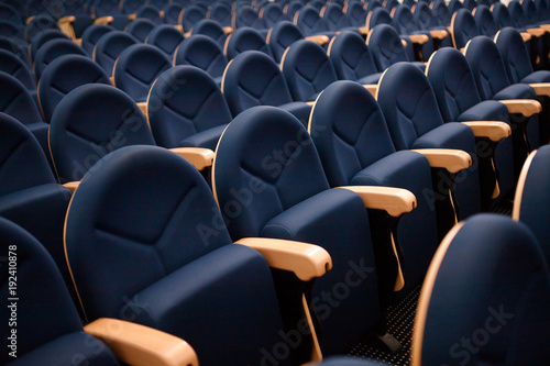 Photo  Seats are arranged in row in hall of opera, theater, cinema