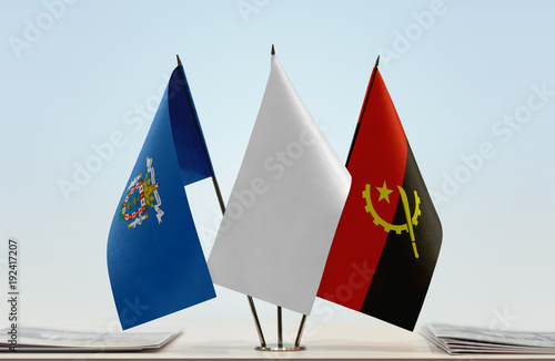 Flags of Melilla and Angola with a white flag in the middle