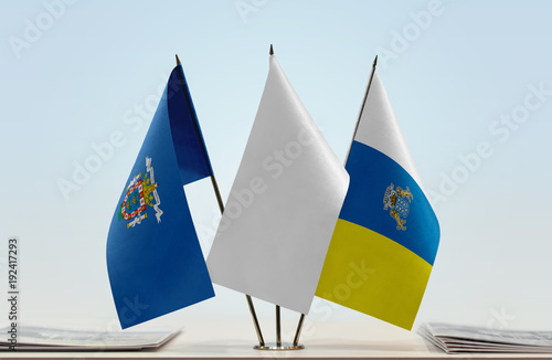 Deurstickers Canarische Eilanden Flags of Melilla and Canary Islands with a white flag in the middle