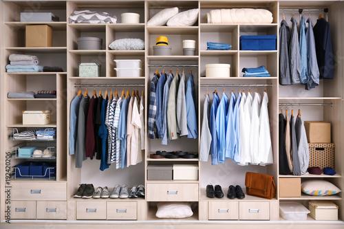 Fotografía  Big wardrobe with male clothes for dressing room